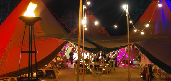 Tipis looking stunning at night with lighting from LighTech